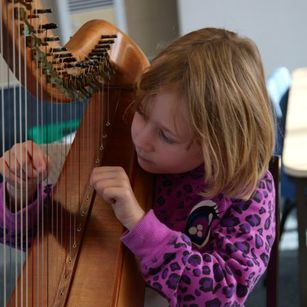 Girl learning to play the harp