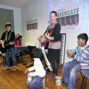 Karen Jones playing music with the children